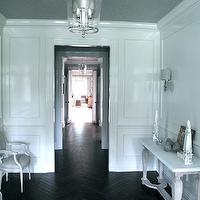 Jane Green - entrances/foyers - espresso, stained, wood floors, herringbone, pattern, French, Louis, chairs, gray, textured, ceiling, console table, wainscoting, wallmoldings,