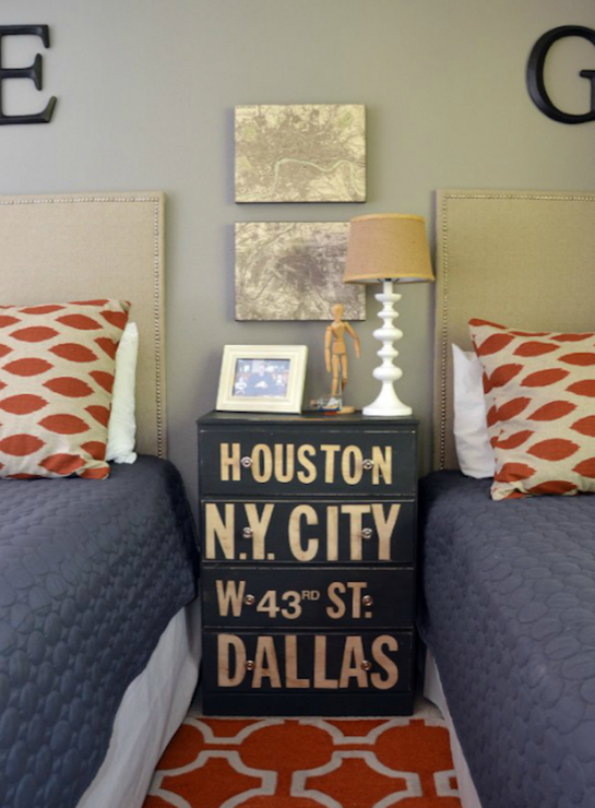 boy's rooms - Chipper Arizona/Denton red tan pillows gray walls black vintage chest orange geometric rug white lamp black wood letters linen nailhead trim twin headboard