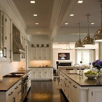 kitchens - industrial kitchen island, pendants, creamy, white, kitchen cabinets, black, granite, countertops, sink in kitchen island, white kitchen cabinets with black countertops,
