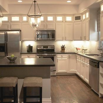 Beautiful kitchen design with creamy white kitchen cabinets with black