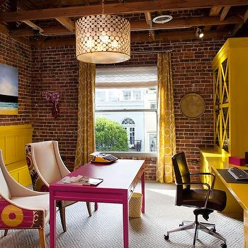 Artistic Designs for Living - dens/libraries/offices - exposed brick wall, white, gray, Greek key, pattern, rug, yellow, drapes, yellow, glass-front, cabinets, yellow, floating, desk, fuchsia, desk, curvy, chairs in Suzani fabric, modern herringbone pattern fireplace, yellow, built-in, bench, yellow curtains, yellow geometric curtains, Oly Studio Serena Drum Pendant, Donghia Suzani Fabric - Pink Passion,