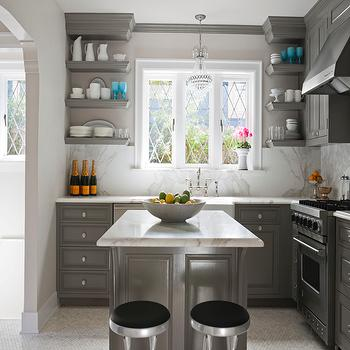 House Beautiful - kitchens - lilac, walls, charcoal, gray, kitchen cabinets, gray, chunky, floating shelves, marble, countertops, marble, slab, backsplash, farmhouse, sink, Perrin & Rowe, Bridge Faucet, gray kitchen cabinets, gray kitchens, gray cabinets, gray islands, gray kitchen islands, Benjamin Moore Stone Harbor, DWR Indecasa TB Counter Stool, Canopy Designs Swedish Chandelier,