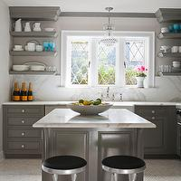 House Beautiful - kitchens - Glidden - Carolina Strand - lilac, walls, charcoal, gray, kitchen cabinets, gray, chunky, floating shelves, marble, countertops, marble, slab, backsplash, farmhouse, sink, Perrin & Rowe, Bridge Faucet, gray kitchen cabinets, gray kitchens, gray cabinets, gray islands, gray kitchen islands,