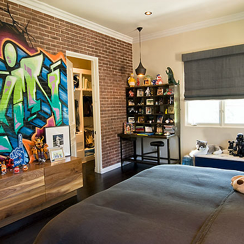Fun boy's bedroom with pale yellow walls paint color, brick wall with graffiti ...