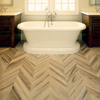 Courtney Blanton Interiors - bathrooms - marble, herringbone, tiles, floor, single, coffee stained, bathroom cabinets, flanking, freestanding, tub, pale, blue, walls, marble floors, marble tile floor, herringbone tiles, herringbone tile floor, herringbone marble tiles, herringbone marble floor, marble herringbone tiles, marble herringbone floor, marble herringbone tile floor,