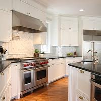 M. E. Beck Design - kitchens - creamy, white, kitchen cabinets, kitchen island, soapstone, countertops, sink in kitchen island, brass, bin pulls, knobs, pot filler, calcutta gold, subway tiles, backsplash, Wolfe, range, vent,