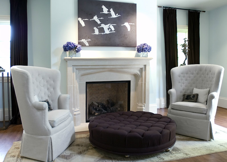Ecomanor - bedrooms - Benjamin Moore - Bird's Egg - robin's egg, blue, walls, limestone, fireplace, purple, hydrangeas, eggplant, velvet, drapes, purple, eggplant, velvet, round, tufted, ottoman, pale, gray, tufted, wingback, chairs,