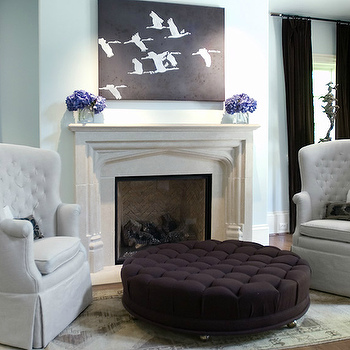 Ecomanor - bedrooms - robin's egg, blue, walls, limestone, fireplace, purple, hydrangeas, eggplant, velvet, drapes, purple, eggplant, velvet, round, tufted, ottoman, pale, gray, tufted, wingback, chairs, birds egg blue, birds egg blue paint, birds egg blue paint colors, purple tufted ottoman,