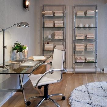Haus Interior - dens/libraries/offices - gray, textured, walls, metal, bookcases, glass-top, sawhorse, desk, round, Beni Ourain, rug, sawhorse desks, polished nickel sawhorse desks, glass sawhorse desks, glass-top sawhorse desks, saw horse desks, West Elm Swivel Leather Desk Chair - White,
