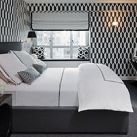 Haus Interior - bedrooms - black, white, geometric, wallpaper, white, roman shade, black, ribbon, trim, built-in, window seat, black, white, circles, pillows, TV, polished chrome, x, console, table, polished nickel, sconces, black, shades, black, platform, bed, white, hotel, duvet, shams, black, stitching, white, black, striped, pillows, glossy, black, nightstands, roman shades, black and white roman shades, white and black roman shades,