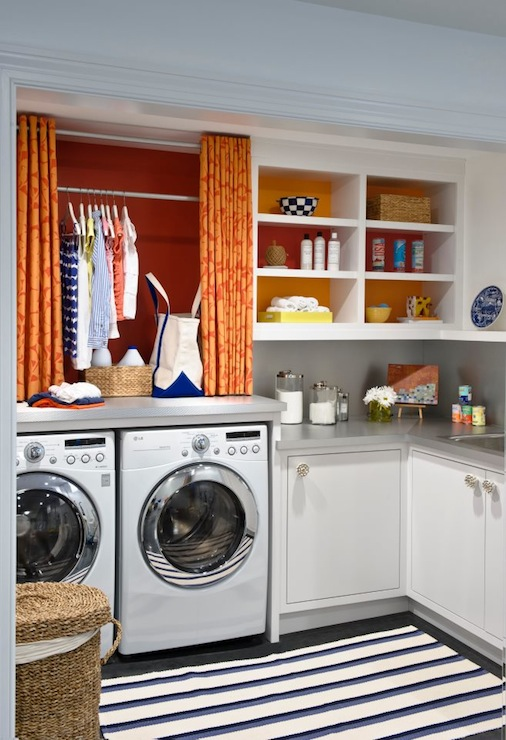 Lucy Interior Design - laundry/mud rooms - Benjamin Moore - Raspberry Pudding - white, cabinets, gray, corian, countertops, white, blue, striped, rug, LG, white, front-load, washer, dryer, orange, red, curtains, raspberry, accent wall, orange curtains, orange drapes, orange window panels,