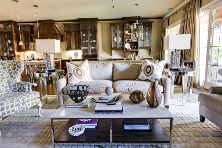 EJ Interiors - living rooms - sofa, lamps, table lamps, table decor, wood cabinets, shell, neutral wall color, curtains, mixed seating, rug, wood floor, glass door, mirrored side table,