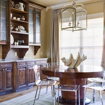 EJ Interiors - dining rooms - wood table, lucite chairs, glass lighting, wood cabinets, curtains, clear shelves, shell, table decor, window, cabinet decor, breakfast table, wood floor, rug. lucite chairs, lucite dining chairs,
