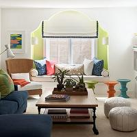Lucy Interior Design - living rooms - Benjamin Moore - Wales Green - green, orange, turquoise, blue, spool, stools, blue, sofa, chaise lounge, green, orange, pillows, TV, fireplace, industrial coffee table, green, walls, alcove, window seat, white, roman shade, white, cushions, blue, piping,