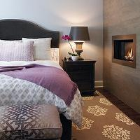 House & Home - bedrooms: modern, fireplace, charcoal, gray, velvet, camel back, headboard, white, purple, bedding, purple, throw, metallic, purple, upholstered, bench,