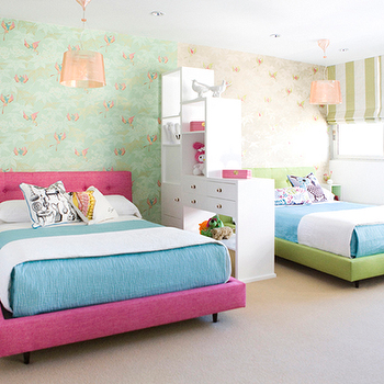 Sweet girls' bedroom with white storage cabinet partition defining each girl's ...