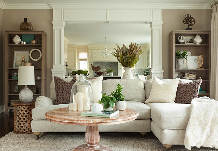 The Elegant Abode - living rooms - cafe au lait, walls, open, bookcases, mirrored, wall, off-white, linen, sofa, chaise lounge, Bamileke stool, table, round, pedestal, coffee table, linen sectional,