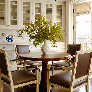 Martha Angus - dining rooms - walnut, round, pedestal, dining table, brown, leather, square back, dining chairs, French doors, ivory, glass-front, kitchen cabinets, marble, slab, countertops, backsplash, leather dining chairs, brown leather dining chairs, brown dining chairs,