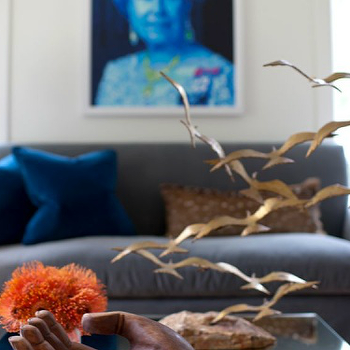 Sally Wheat Interiors - living rooms - Queen Elizabeth, pop, art, blue sofa, mirrored, coffee table, brass birds, brass birds art sculpture, brass birds sculpture, birds art sculpture,
