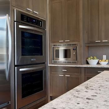 Veranda Interiors - kitchens - Bianco Argento, granite, countertops, double ovens, white granite countertops, white granite,  Amazing kitchen