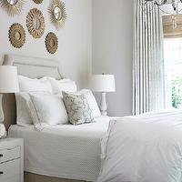 Courtney Giles Interiors - bedrooms - gray, walls, gallery, gold, sunburst, mirrors, gray, linen, headboard, gray, bed skirt, white, nightstands, marble, lamps, gray, sheers, layered, bamboo, roman shades, sunburst mirror, gold sunburst mirror, sunburst wall decor, collection of sunburst mirrors, sunburst wall decor,