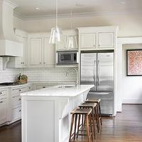 Courtney Giles Interiors - kitchens - tapered, clear, glass, pendants, white, shaker, kitchen cabinets, kitchen island, marble, countertops, sink in kitchen island, subway tiles, backsplash, backless, wood, counter stools, shaker cabinets, shaker kitchen cabinets,
