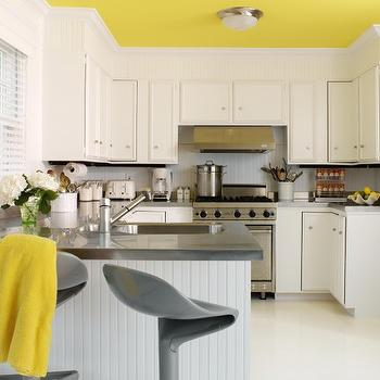 Tara Seawright - kitchens - yellow, painted, ceiling, beadboard, backsplash, white, beadboard, kitchen peninsula island, gray, quartz, countertops, yellow and gray rooms, gray and yellow rooms, beadboard peninsula, beadboard kitchen peninsula, yellow and gray rooms, yellow and gray kitchen, Kartell Spoon Stool,
