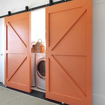 House Beautiful - laundry/mud rooms - Benjamin Moore - Fresno - tangerine, painted, sliding, barn doors, white, front-load, washer, dryer, barn doors, orange barn doors, interior barn doors,