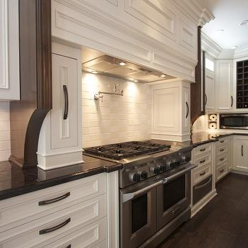 Robeson Design - kitchens - stainless steel, warming drawer, pot filler, white, kitchen cabinets, Marron Cohiba, Granite, countertops, subway tiles, backsplash, pull out spice cabinets, spice cabinets,
