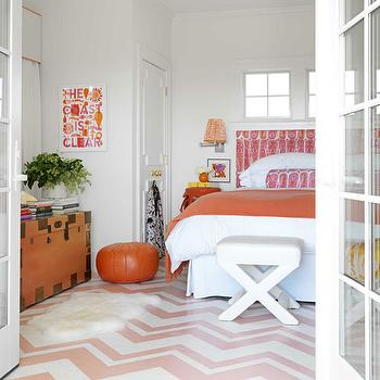 House Beautiful - bedrooms - Benjamin Moore - Salmon Berry - white, pink, chevron, painted, floor, hot pink, paisley, headboard, bolster, pillow, white, x-bench, orange, throw, pink chevron floor, chevron floor,
