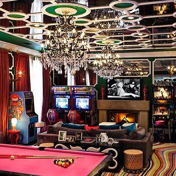 Douglas Friedman - media rooms: mirrored, ceiling, red, silk, drapes, pink, pool table, pinball machines, video games, leather, sofa, fireplace, game room, games room,