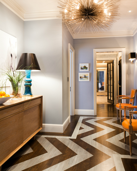 Thom Filicia - entrances/foyers - gray, walls, sea urchin, pendant, chandelier, coffee stained, wood floors, painted, silver, gray, chevron, herringbone, pattern, mid-century modern, credenza, turquoise, blue, lamp, orange, Louis, chairs, chevron floor, chevron foyer floor,