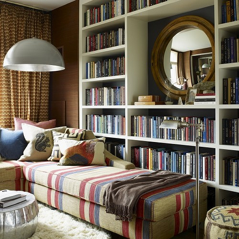 Thom Filicia - dens/libraries/offices - white, built-in, bookcase, organized, library, white, round, flokati, rug, wood, round, mirror, red, blue, ta, striped, chaise lounge, striped lounge, striped chaise lounge, Roost Pasha Coffee Table, Kilim Ottoman,