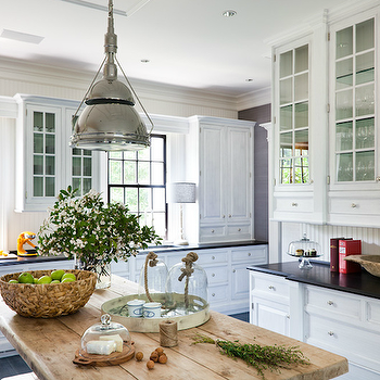 Thom Filicia - kitchens - rustic, wood, farmhouse, kitchen island, white, glass-front, kitchen cabinets, black, honed, granite, countertops, vintage, wood platter, glass, cloches, rustic kitchen island, farmhouse kitchen island, rustic kitchen island, Thomas O'Brien Garey Industrial Pendant,