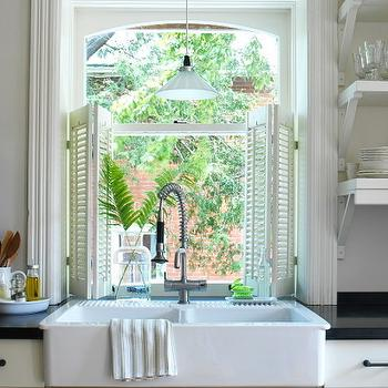 Margot Austin - kitchens: white, shutters, farmhouse, sink, white, kitchen cabinets, Absolute Black, granite, countertops, shutters, white shutters, kitchen shutters, white kitchen shutters,