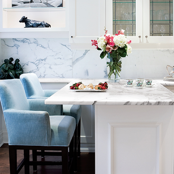 Style at Home - kitchens - blue, counter stools, white, glass-front, kitchen cabinets, kitchen island, peninsula, marble, slab, backsplash, blue counter stools, blue bar stools,