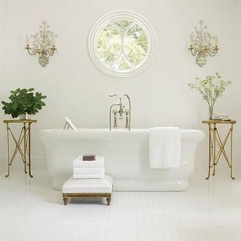 Architectural Digest - bathrooms - skylight, brass, directoire, accordion, round, tables, freestanding, tub, white, gold fretwork, ottoman, bathroom table, bathroom accent table, brass directoire table, directoire table,