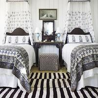 Architectural Digest - girl's rooms - twin, camel back beds, white, sheer, bed, canopy, black, Asian, console, table, vertical, groove, walls, gray, blankets, canopy bed, girl canopy bed, girls canopy bed, canopy beds for twin girls, black and white striped rug, Madeline Weinrib Atelier Black & White Buche Rug,