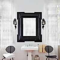 Architectural Digest - bathrooms - glossy, black, fretwork, mirror, glossy, white, pedestal, sink, sconces, yellow, towels,  May Daouk's Beirut