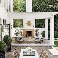 Architectural Digest - decks/patios - covered, gold, sunburst, mirror, outdoor, fireplace, outdoor, furniture, French doors, covered deck, covered patio,