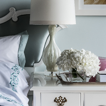 Janet Rice Interiors - bedrooms - gray, walls, white, ornate, blue, silk, headboard, glossy, white, lacquer, nightstand, white, lamp, silver, serving tray, blue, bedding, hollywood regency, hollywood regency design, hollywood regency bedroom,