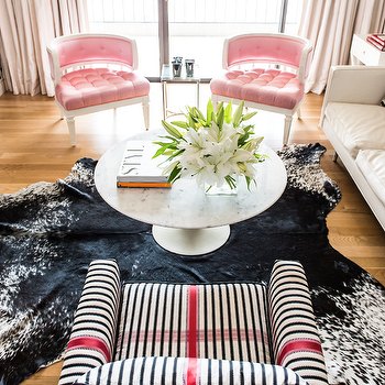 Janet Rice Interiors - living rooms - Hollywood Regency, pink, tufted, chairs, ivory, drapes, black, white, cowhide, rug, marble, top, Saarinen, coffee table, white, black, striped, chair, pink, ribbon, trim, pink chairs, pink tufted chairs, pink velvet tufted chairs, pink velvet chairs,