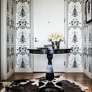 Janet Rice Interiors - entrances/foyers - blue, black, medallion, print, wallpaper, brown, cowhide, rug, glossy, black, pedestal, table, silver, ice bucket, white, roses, silhouette, art, round foyer table, foyer table, foyer, round entry table, entry table, round entrance table, entrance table,