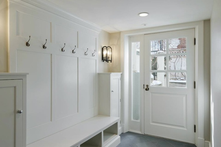 Suzie: Cameo Homes - Great mudroom with white built-ins and slate tiles floor.