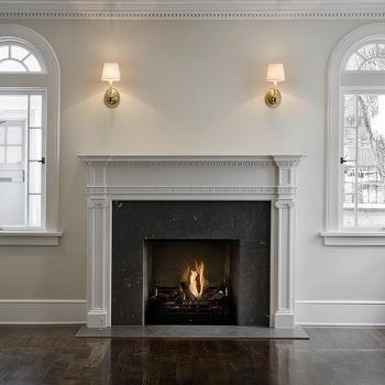 Cameo Homes - living rooms - glossy, wood, floors, arched, windows, flanking, light, gray, painted, fireplace, mantle, black, marble, tiles, gray, walls, gray mantle, gray mantel, gray fireplace mantle, gray fireplace mantel,