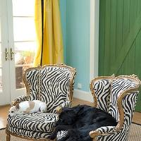 Marmalade Interiors - living rooms - doggies, turquoise, blue, walls, yellow, silk, drapes, black, velvet, fretwork, Greek key, trim, green, barn door, gold, French, chairs, zebra, fabric, sisal, rug, zebra chairs, bergere chairs, zebra bergere chairs,