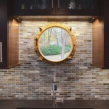 Aidan Design - kitchens - gold, porthole, mirror, chocolate, brown, kitchen cabinets, black, quartz, countertops. blue, brown, linear, glass tiles, backsplash, pothole window, gold porthole window,