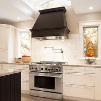 Aidan Design - kitchens - ebony, wood panel, range hood, pot filler, glossy, subway tiles, backsplash, pot filler, white, kitchen cabinets, granite, countertops, black, beadboard, kitchen island, black kitchen hood, black paneled hood, black exhaust hood, black paneled kitchen hood,