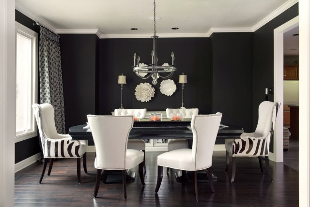 Ramsey Interiors - dining rooms - Benjamin Moore - Caviar - Global Views Carnation Wall Flower Decorative Accent in Pearl White, Global Views Carnation Platter/Bowl Decorative Accent in Pearl White, Candice Olson Light Aristocrat Chandelier, black, walls, glossy, black, dining room, table, ivory, nailhead trim, side, chairs, zebra, captain, dining chairs, black walls, black paint, black paint color,