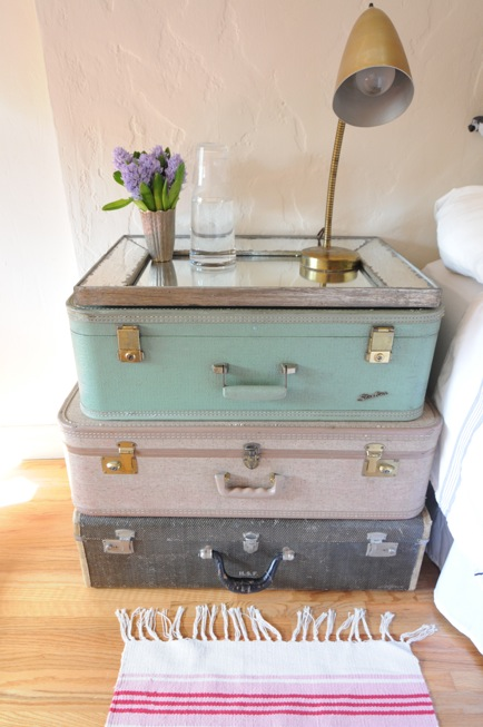 Cupcakes and Cashmere - bedrooms - nightstand, pastel, stacked, vintage, suitcases, rustic, beveled, mirror, tray, antique brass, pharmacy lamp, stacked suitcases, vintage stacked suitcases, stacked suitcases nightstand,
